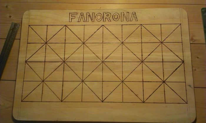 Our home made Fanorona board. Made on a chopping board using a soldering iron to brand.