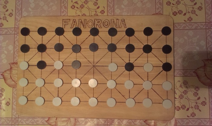 The starting set up of Fanorona on or home made board.