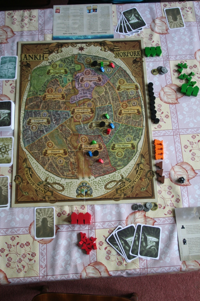 You can't see the actual numbers or names of the areas the board's divided into in this picture, but you can see the minions we  had on the board to start, and that there's a trouble marker in each area with them. Which is good enough for now.