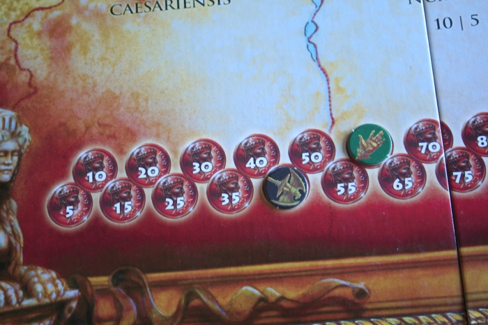 The tokens for each player show the amount of money they get each turn.