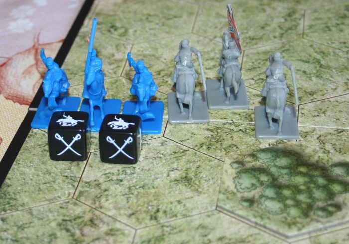 Of the three Battle Dice rolled here two were hits. As you can see, the small image on the dice is of a Cavalry figure. When rolling to eliminate opponents you must roll the correct symbols.